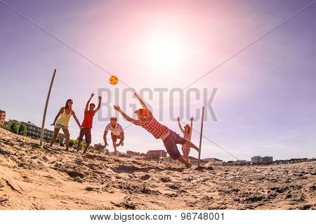 Multiracial Friends Playing Soccer At Beach - Concept Of Multi Cultural Friendship Having Fun