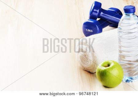 Fitness Concept With Dumbbells, Green Apple And Water Bottle