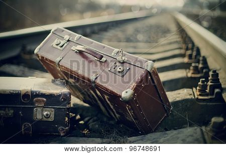 Old Fashioned A Suitcases On Railroad Tracks