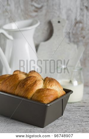 Brioche In The Baking Dish On A Light Wooden Background