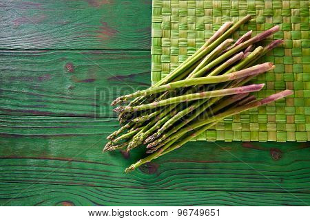 green asparagus fresh on wooden monochrome rustic table