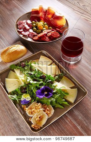 Spain food tapas ham sausage and salad with cheese honey and nuts