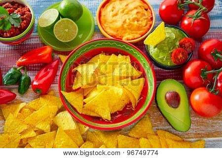 Mexican food nachos and guacamole with chili peppers and sauces