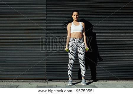 Sexy female look to you while taking break during her training against copy space background