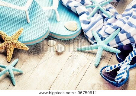 Summer Holiday Setting With Flip Flops And Beach Wear