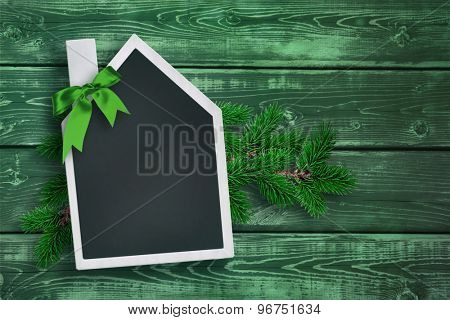 House shaped chalkboard with Christmas background