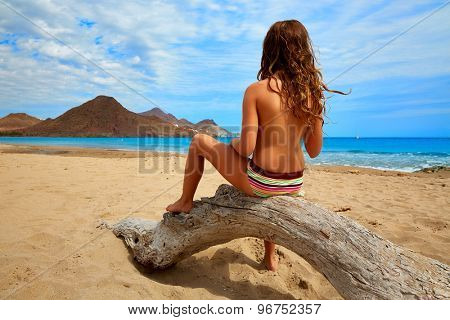 Almeria Playa de los Genoveses beach girl back in Cabo de Gata Spain