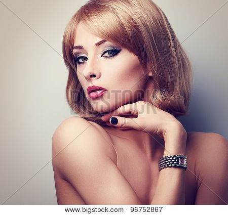 Beautiful Blonde Makeup Woman Posing In Fashion Watches On The Hand. Closeup Portrait