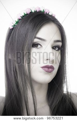 Black and white portrait of a beautiful young woman with purple lips and blue eyes