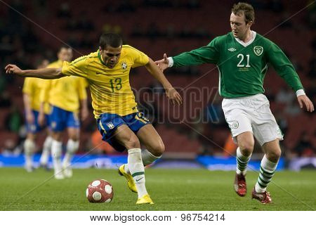 LONDON, ENGLAND. March 02 2010: Brazil's Luisao and Irelands Aiden McGeady during the international football friendly between Brazil and the Republic of Ireland played at the Emirates Stadium.