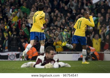 LONDON, ENGLAND. March 02 2010: Barzil's Robinho celebrates scoring a goal as Irelands Shay Given reacts during the international football friendly between Brazil and the Republic of Ireland