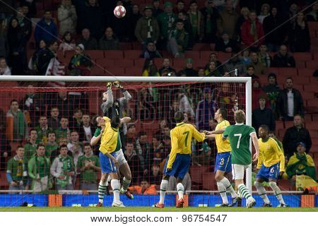 LONDON, ENGLAND. March 02 2010: Brazil's goalkeeper Julio Cesar punches the ball clear during the international football friendly between Brazil and the Republic of Ireland