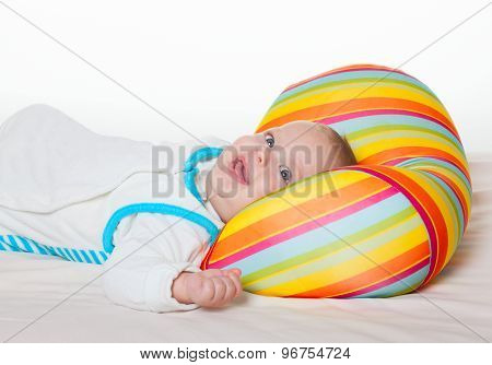 Cute Happy Baby With Bright Cushion