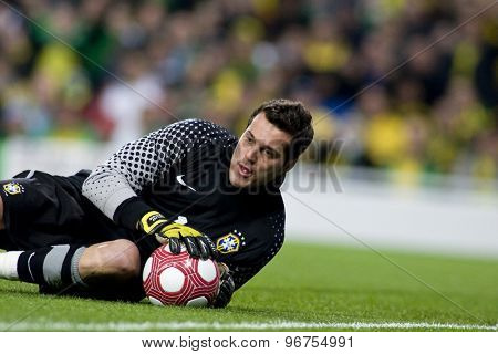 LONDON, ENGLAND. March 02 2010: Brazil's goalkeeper Julio Cesar makes a save during the international football friendly between Brazil and the Republic of Ireland played at the Emirates Stadium.