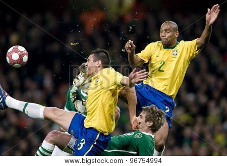 LONDON, ENGLAND. March 02 2010: Brazil's captain Lucio gets kicked in the head by Brazil's Maicon during the international football friendly between Brazil and the Republic of Ireland