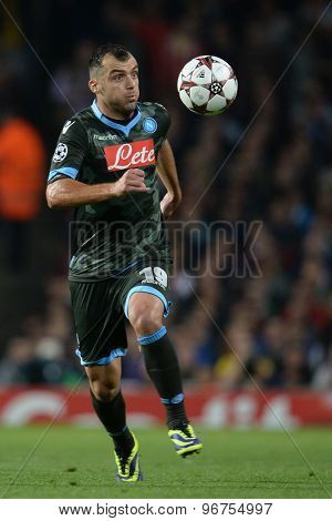 LONDON, ENGLAND - Oct 01 2013:  Napoli's forward Goran Pandev from Macedonia runs with the ball during the UEFA Champions League match between Arsenal and Napoli.