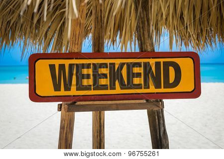 Weekend sign with beach background