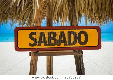 Saturday (in Spanish/Portuguese) sign with beach background