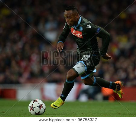 LONDON, ENGLAND - Oct 01 2013: Napoli's defender Camilo Zuniga from Columbia runs with the ball during the UEFA Champions League match between Arsenal and Napoli.
