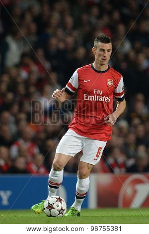 LONDON, ENGLAND - Oct 01 2013: Arsenal's defender Laurent Koscielny from France during the UEFA Champions League match between Arsenal and Napoli.