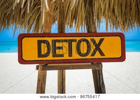 Detox sign with beach background