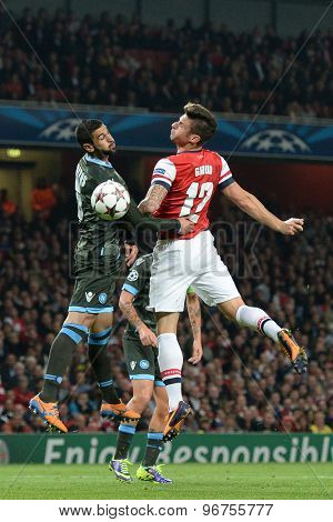 LONDON, ENGLAND - Oct 01 2013: Napoli's defender Raul Albiol and Arsenal's forward Olivier Giroud from France compete for the ball during the UEFA Champions League match between Arsenal and Napoli.
