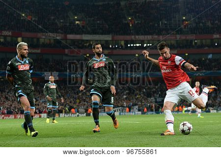 LONDON, ENGLAND - Oct 01 2013: Arsenal's forward Olivier Giroud from France takes a shot at goal during the UEFA Champions League match between Arsenal and Napoli.