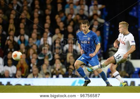LONDON, ENGLAND - September 19 2013: Tottenham's Lewis Holtby crosses the ball during the UEFA Europa League match between Tottenham Hotspur and Tromso played at The White Hart Lane Stadium.
