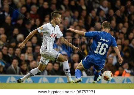 LONDON, ENGLAND - September 19 2013: Tottennham's Erik Lamela and Tromso's Lars Gunnar Johnsen during the UEFA Europa League match between Tottenham Hotspur and Tromso played at The White Hart Lane