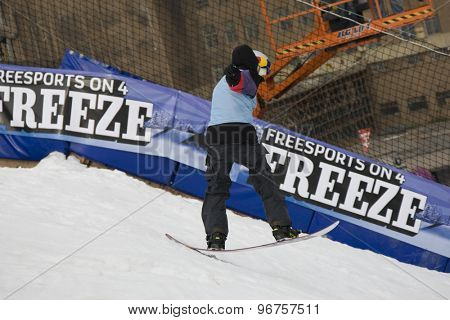 LONDON, ENGLAND. October 30 2009 A competitor takes to the air during the training run for the London Freeze snowboard and freestyle skiing event.