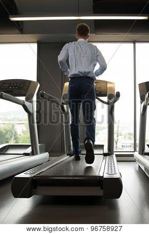 Businessman Running On Treadmill