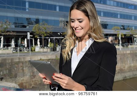 Business Woman Working On A Tablet.
