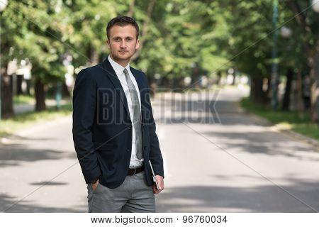 Portrait Of A Confident Businessman Outdoors In Park