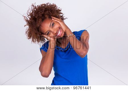 Young African American Woman Holding Her Frizzy Afro Hair - Black People