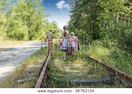 Three girls on the railway