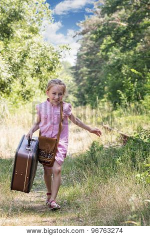 Running girl with suitcase