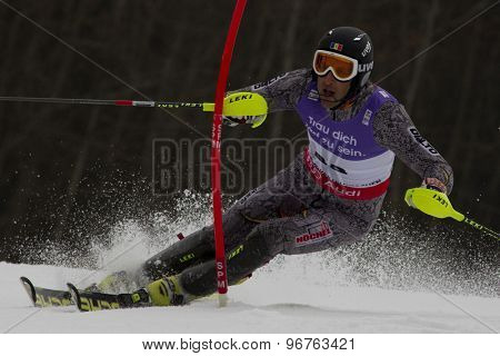 GARMISCH PARTENKIRCHEN, GERMANY. Feb 19 2011: Urs Imboden (MDA)  competing in the mens  slalom race , at the 2011 Alpine skiing World Championships