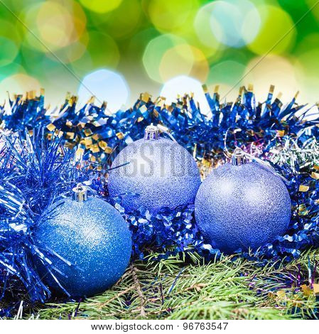 Xmas Blue Balls On Blurred Green Background