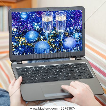 Man Touches Laptop With Blue Xmas Still Life