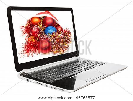 Xmas Still Life With Red And Blue Balls On Laptop