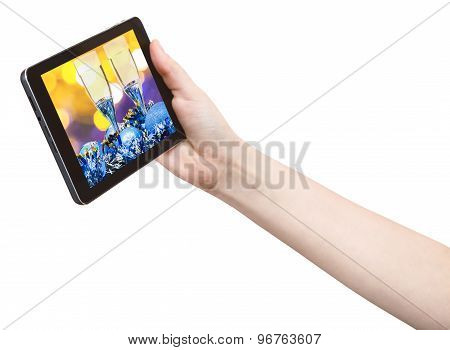 Hand Holds Tablet Pc With Xmas Still Life