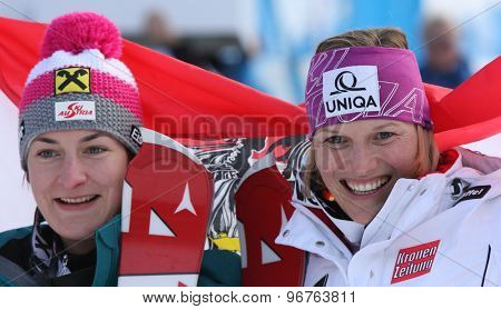 GARMISCH PARTENKIRCHEN, GERMANY. Feb 19 2011: Kathrin Zettel (AUT) (L) 2nd, Race winner Marlies Schild (AUT) (R) during the flower ceremony of the slalom race