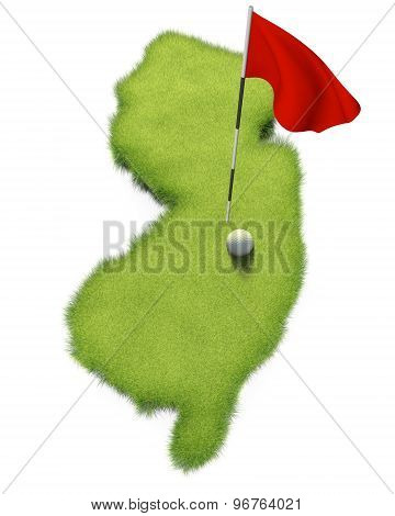 Golf ball and flag pole on course putting green shaped like the state of New Jersey