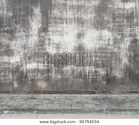 Urban background. Grunge obsolete street wall texture with deleted graffiti.