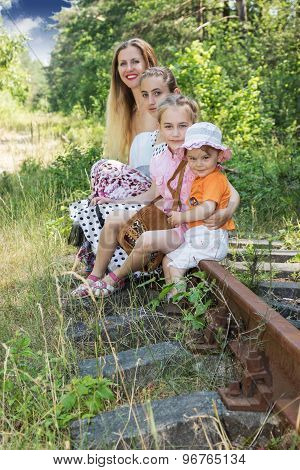 Mother with the daughter on rails