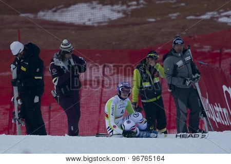 GARMISCH PARTENKIRCHEN, GERMANY. Feb 17 2011: RIESCH Maria (GER) sits by her coach after crashing out of the women's giant slalom  race  at the 2011 Alpine skiing World Championships