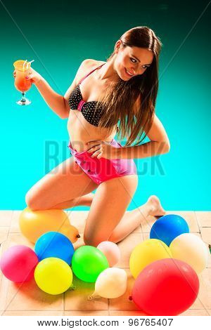 Woman Holding Tropical Drink On Pool.