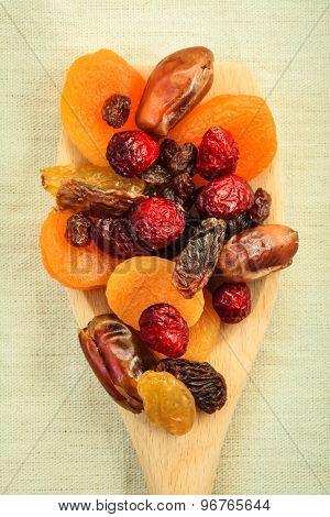 Varieties Of Dried Fruits On Wooden Spoon.