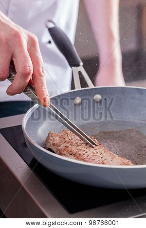 chef making steak