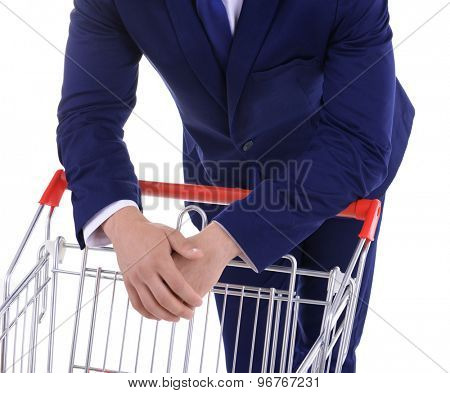 Young man with empty shopping cart, isolated on white